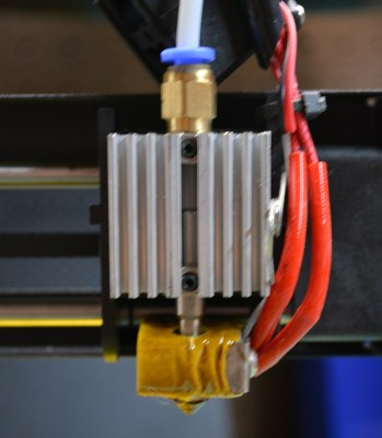 The hotend. Note the air gap between the Bowden end and the beginning of the heat break. When changing out filament, it can jam in this air gap