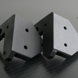 Unsanded left, sanded right, Z-motor mount for Prusa i3 rework.
