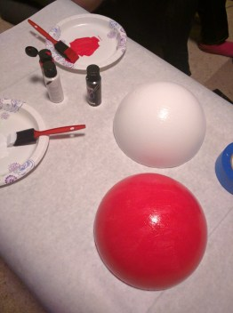 Acrylic paint turns the styrofoam into a Pokéball