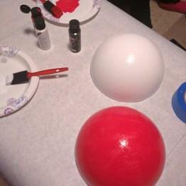 Acrylic paint turns the styrofoam into a Pokéball