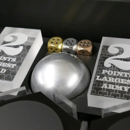 The bonus trophies, made from thick acrylic.