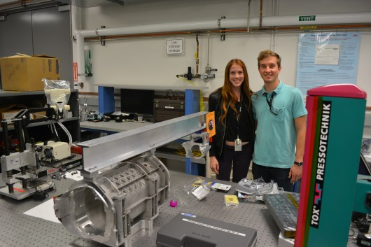 Michelle Easter and Mieszko Salamon with parts of Mars 2020 drill prototype