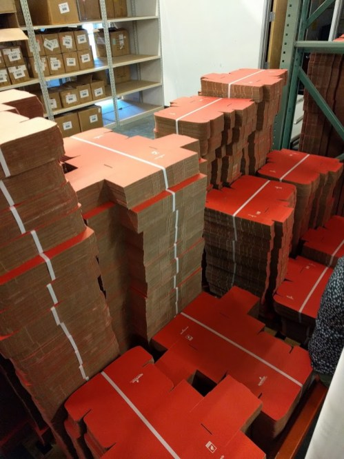 Pallets of familiar red boxes