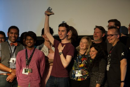 Alex Williams (Grand Prize) holds up the trophy, Vijay Varada (Best Product) to his right