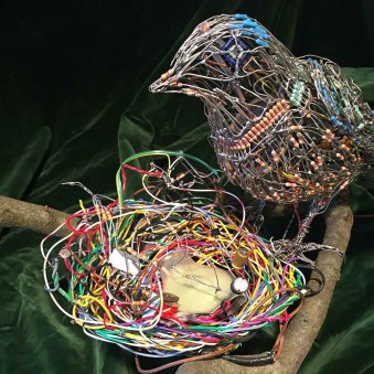 Bird and nest has tweeting chicks controlled by light sensor