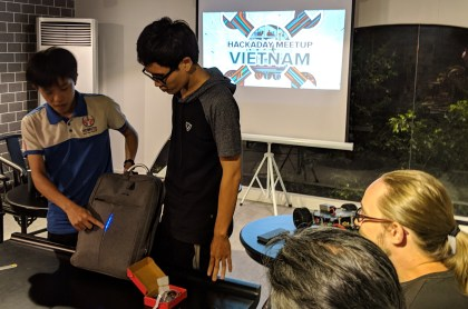 Demonstrating the WS2812 strip added to a backpack.
