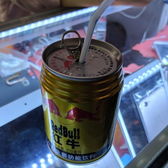 Red Bull with pop-top and straw