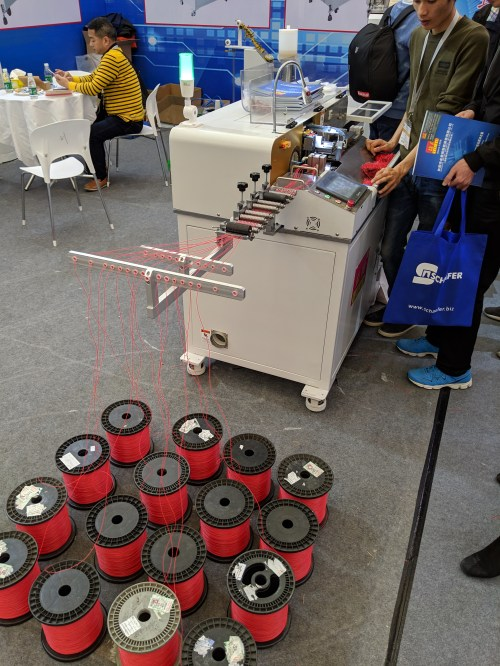 Wide view of the wire-cutting robot shown in the animation above. 16 spools of wire are feeding into this machine.