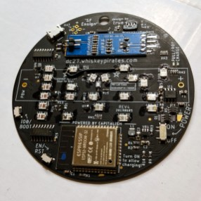 Back of badge shows jumper wire and upside-down LEDs