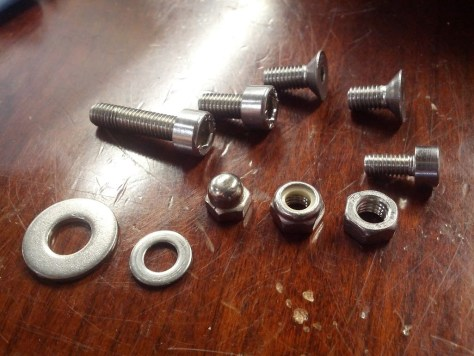 4 and 5mm fasteners. Makes much more sense than some fraction of an average Scottish man's thumb.