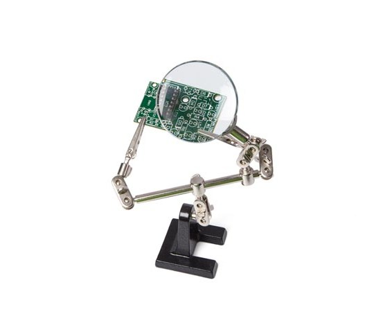 Helping Hands With Magnifying Glass Holding Circuit Board