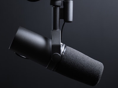 Hacking The Self Podcast Thumbnail - black microphone against black background