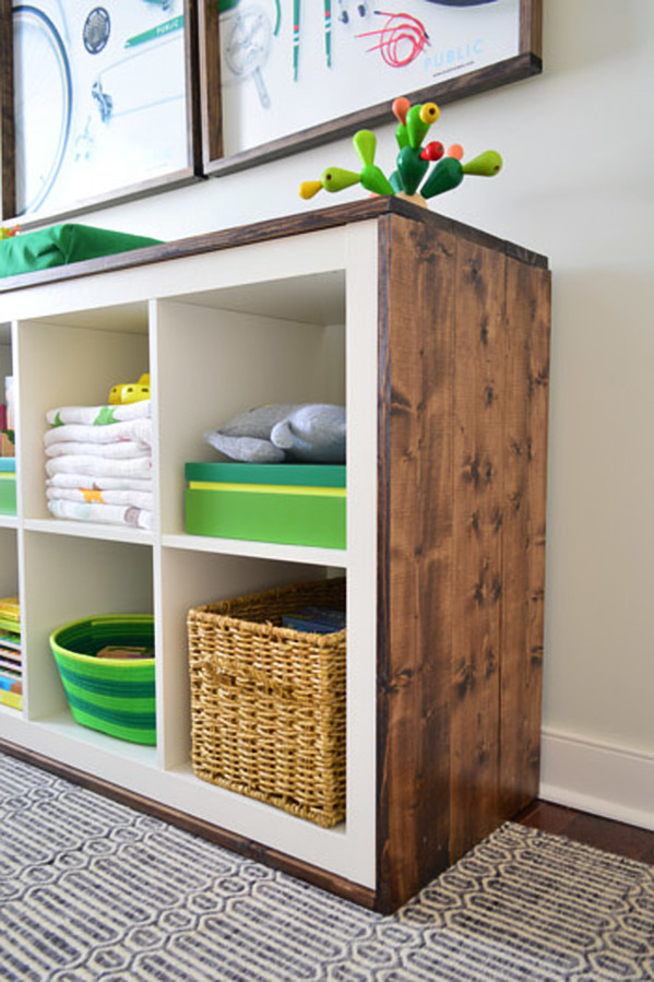 Ikea Kallax Wood Clad Unit Hack  - changing station in a baby's nursery by Young House Love. #ikeahacks #kallax #changingtable #nursery #diy #homedecor