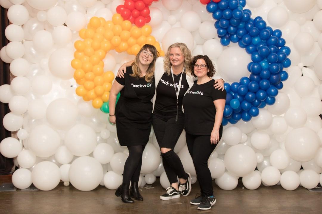 three females wearing Hackworks tshirts