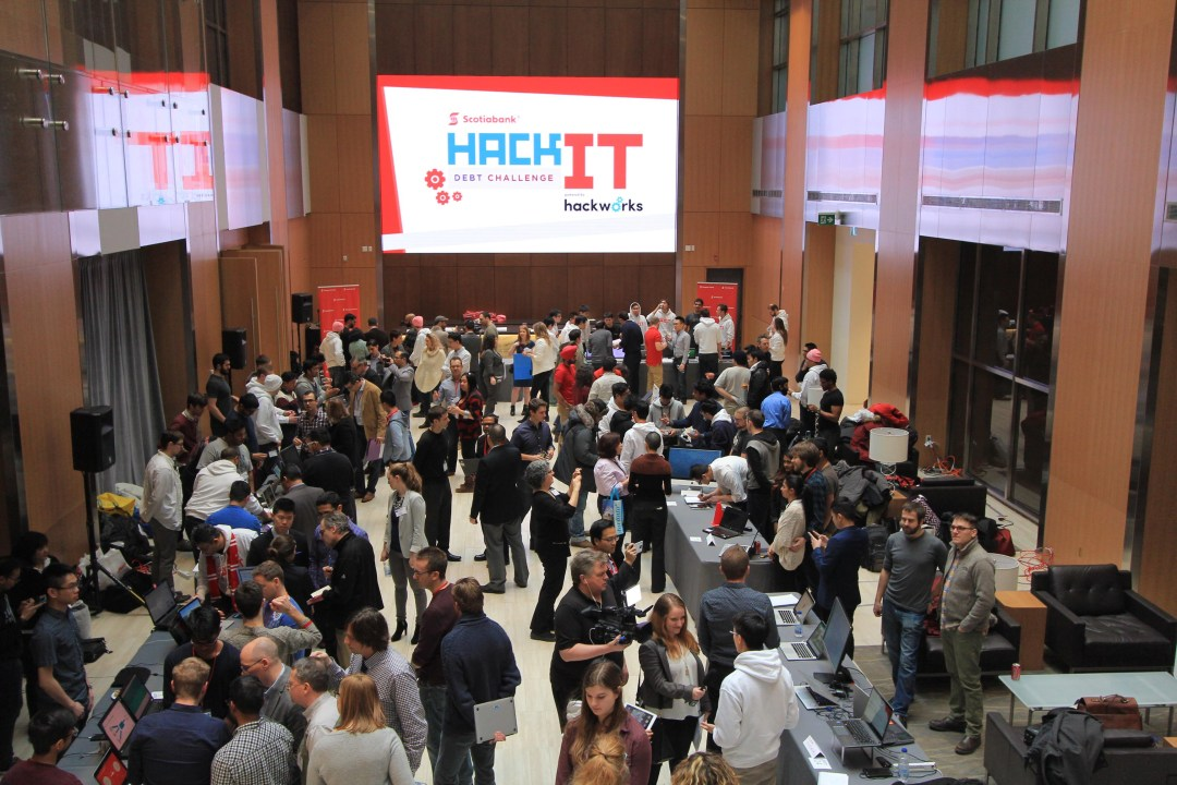 People standing in a hall at Scotiabank HackIT event