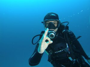 Diver waving the OK sign