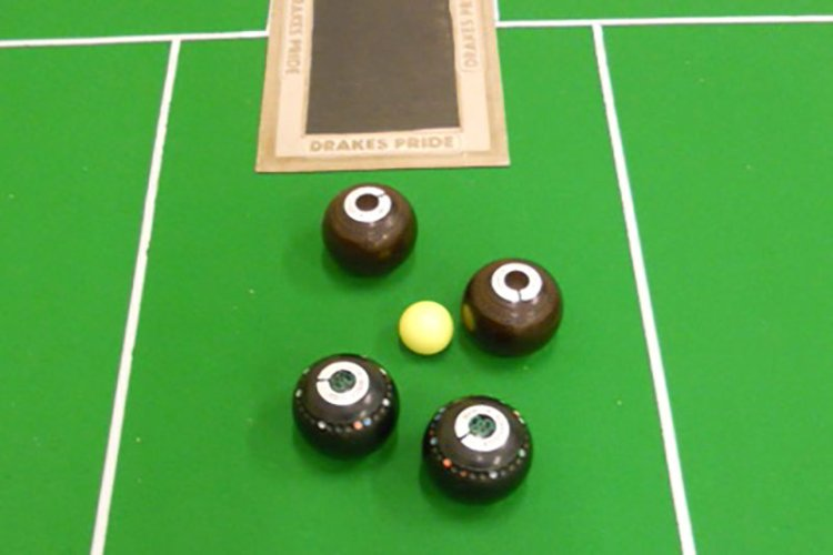 4 bowls around a yellow ball