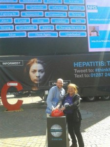 Dan and Petra (from the Hep C Trust) push the button to knock down the virtual wall of Hep C stigma