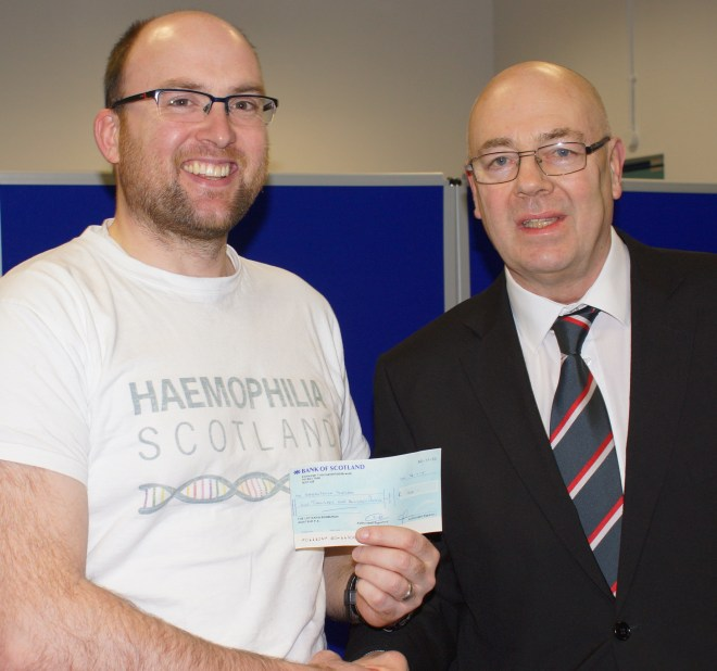 Dan receives the cheque from the LEAFA President