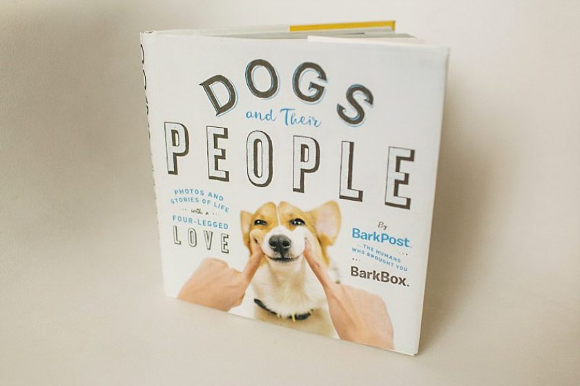 "A photo of the book ""Dogs and Their People."""