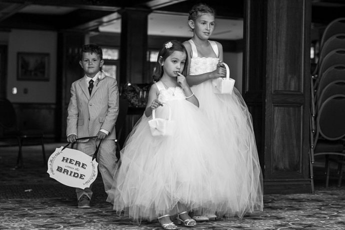 The flower girls and ring bearer wait patiently for their entrance into the ceremony.