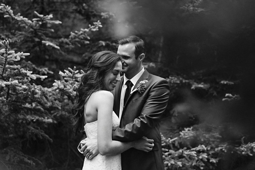 Bride and groom share a private moment in Acadia National Park.