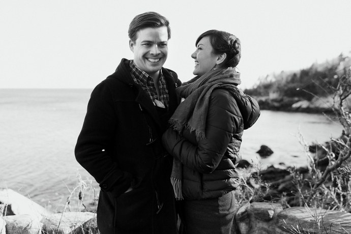 Black and white photo of couple laughing