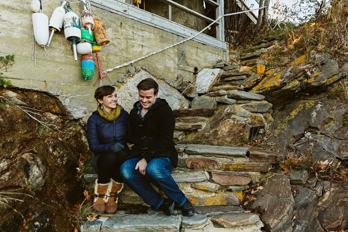 Couple sitting on stairs, laughing