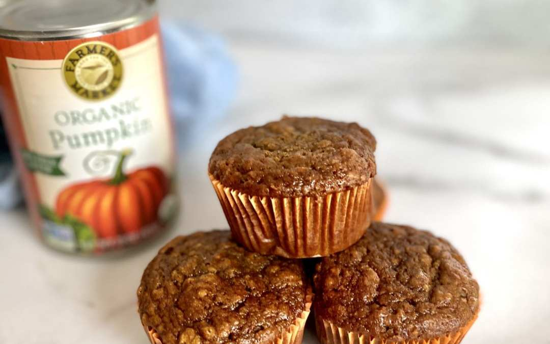 yacon pumpkin muffins on a marble counter with can in the background