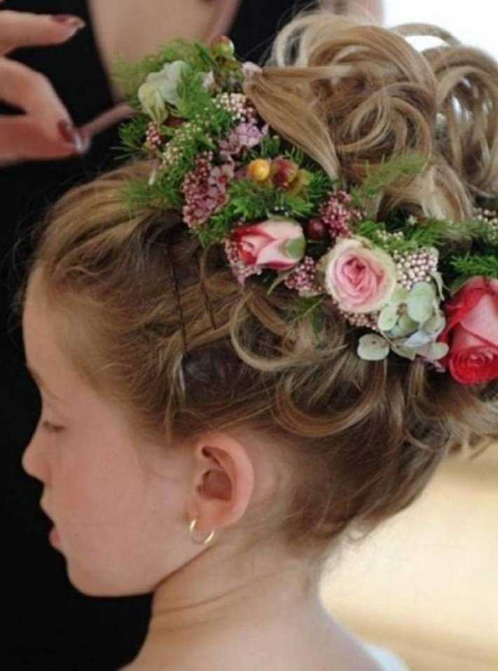 Lovely Updo For Girls With Curls And Flower Decorations