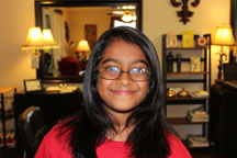 Anna after a straightener service, with her cute smile and new look!