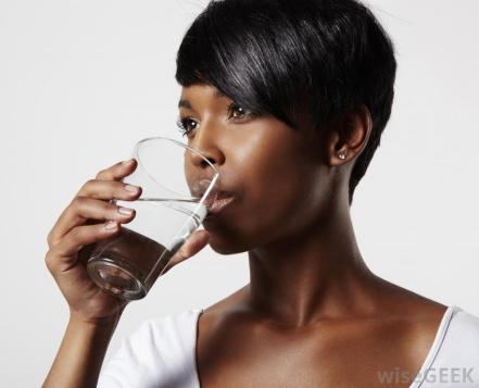 woman-with-black-hair-drinking-from-glass-of-water