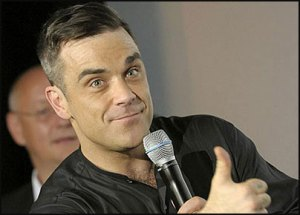 robbie-williams-admits-hair-transplant