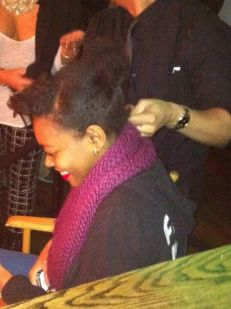 It's Kira (daughter of Michelle of Radiant Brown Beauty) getting her hair did by the D&L stylist.