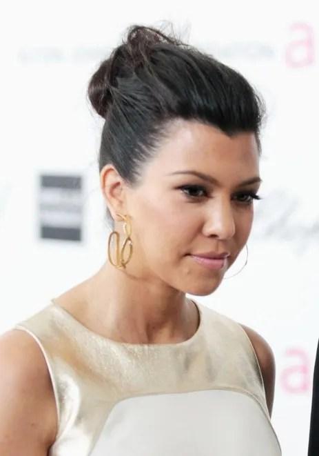 kourtney kardashian black casual loose bun updo hair style