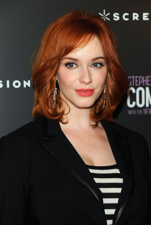 Medium Fiery Red Wavy Hairstyle for Women