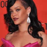 Rihanna Long Hairstyles: Black Wavy Hairstyle with Bangs