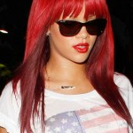 Rihanna Long Sleek Red Hairstyle with Bangs