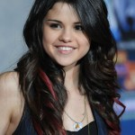 Selena Gomez Long Wavy Hairstyles: Black Hair with Red Highlights
