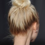 Messy Topknot with Dark Roots