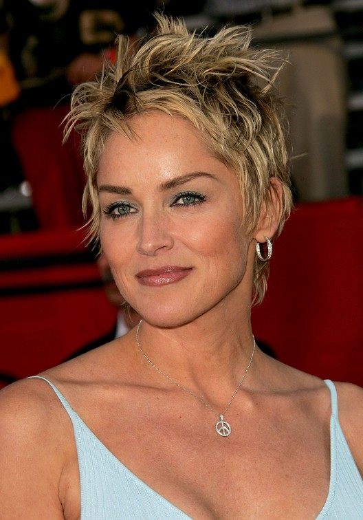 Layered tousled short pixie haircut for women over 50: Sharon Stone Hairstyles