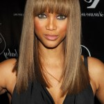 long sleek hairstyle with blunt bangs for black women Tyra Banks hairstyle
