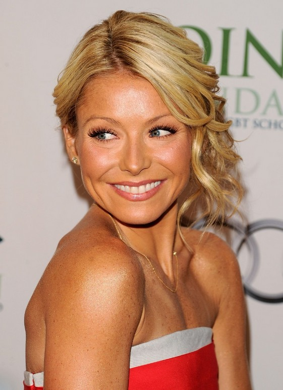 Messy blonde updo for women - Kelly Ripa's Hairstyle
