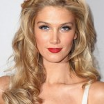 Long blonde wavy hair style with braided headband - Delta Goodrem hairstyles