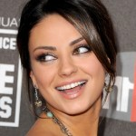 Mila Kunis hairstyles: elegant updo with side swept bangs