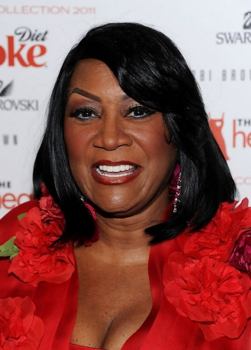 Patti LaBelle Medium Layered Straight Hairstyle with Bangs