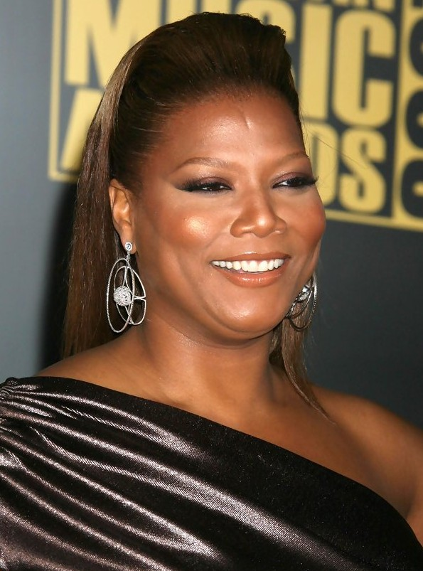 Queen Latifah's 1960s Retro Hairstyle for Long Hair