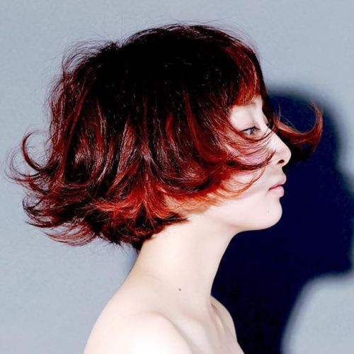 Cool short red wavy bob hairstyle for Asian women