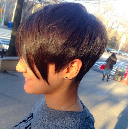 Short dark pixie haircut with long bangs for fine thick hair