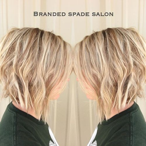 Side view of short blonde angled bob hairstyle